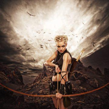 woman with a bow against dark sky